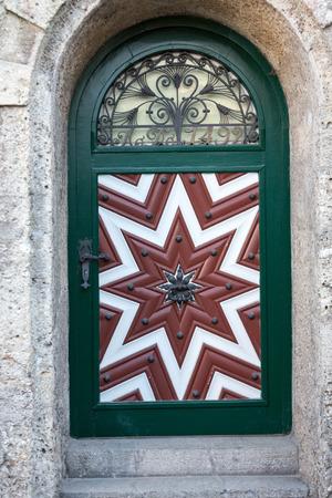 threshold: Wooden door in old town of Salzburg. Austria