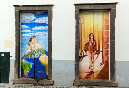 revitalization: FUNCHAL, PORTUGAL - SEPTEMBER 4, 2016: the art of open door in the street of Santa Maria. A project which aims to open the city to artistic and cultural events. Editorial
