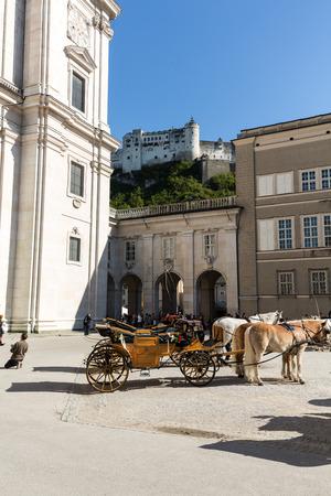 SALZBURG, AUSTRIA, - APRIL 29, 2016: Fiaker  at Cathedral Square in Salzburg, Austria