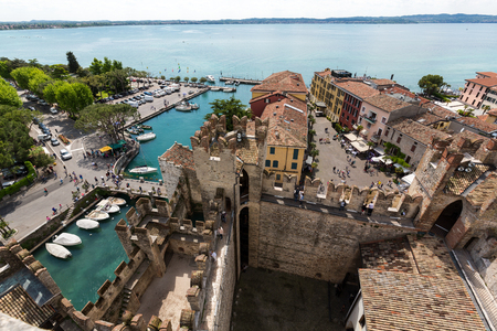 SIRMIONE, ITALY - MAY 5, 2016: View of colorful old buildings in Sirmione and Lake Garda from Scaliger castle wall, Italy