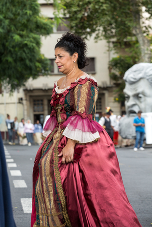 solemnize: FUNCHAL, MADEIRA, PORTUGAL - SEPTEMBER 4, 2016:  Woman in historical fashion dress durnig historical and ethnographic  parade of Madeira Wine Festival in Funchal. Madeira, Portugal