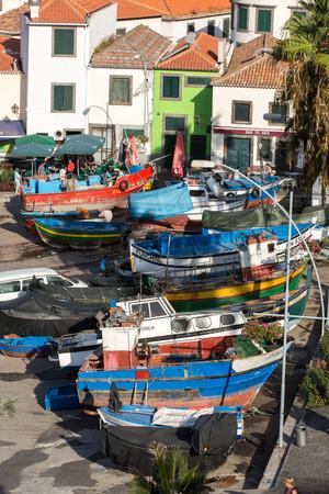 kilometres: CAMARA DE LOBOS, MADEIRA, PORTUGAL - SEPTEMBER 5, 2016: Camara de Lobos - traditional fishing village, situated five kilometres from Funchal on Madeira. Portugal