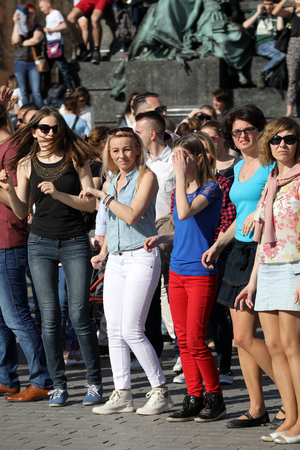 CRACOW, POLAND - APRIL 1, 2017: International Flashmob Day of Rueda de Casino, 57 countries, 160 cities. Several hundred persons dance Hispanic rhythms on the Main Square in Cracow. Poland Editorial