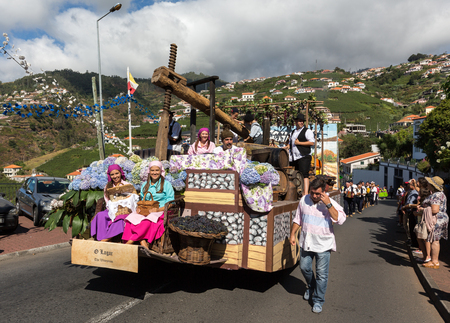 ethnographic: ESTREITO DE CAMARA DE LOBOS, PORTUGAL - SEPTEMBER 10, 2016: People wearing in traditional costumes at Madeira Wine Festival in Estreito de Camara de Lobos, Madeira, Portugal. The Madeira Wine Festival honors the grape harvest with a celebration of traditi