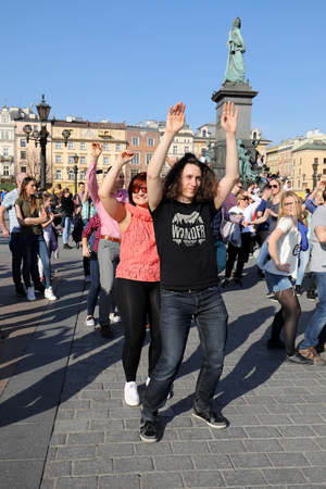 rythm: CRACOW, POLAND - APRIL 2, 2016: International Flashmob Day of Rueda de Casino, 57 countries, 160 cities. Several hundred persons dance Hispanic rhythms on the Main Square in Cracow. Poland