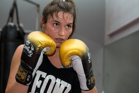 CRACOW, POLAND - FEBRUARY 12, 2016: Agnieszka Niestoj - talented Polish boxer durning boxing training with coach in the gym. Cracow, Poland