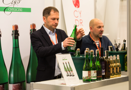 full bodied: CRACOW, POLAND - NOVEMBER 17, 2016:  International Wine Trade Fair ENOEXPO in Cracow is a professional event dedicated to wine. Every year the producers of wine from all around the world meet the importers, distributors and representatives. Cracow. Poland