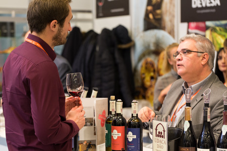 wine trade: CRACOW, POLAND - NOVEMBER 17, 2016:  International Wine Trade Fair ENOEXPO in Cracow is a professional event dedicated to wine. Every year the producers of wine from all around the world meet the importers, distributors and representatives. Cracow. Poland
