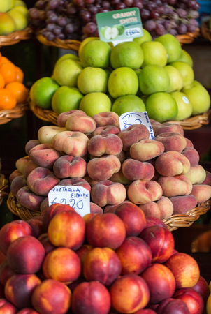 anona: FUNCHAL, PORTUGAL - SEPTEMBER 2, 2016: Fresh exotic fruits on famous market in Funchal (Mercado dos Lavradores), Madeira island, Portugal