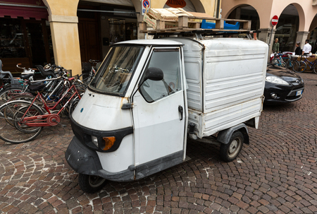 PADUA, ITALY - MAY 3, 2016: Piaggio Ape50 in Rome. Piaggio Ape is a three-wheeled light commercial vehicle first produced in 1948 by Piaggio. Padua, Italy Editorial