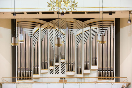 executor: CRACOW, POLAND - SEPTEMBER 25, 2015:  View of the stage of the concert hall at the Cracow Philharmonic with the new Orgelbau organ in the background. Cracow, Poland