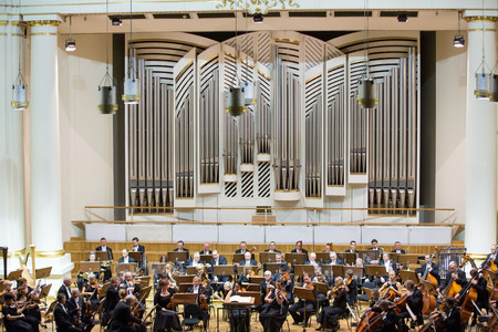 CRACOW, POLAND - SEPTEMBER 25, 2015:  View of the stage of the concert hall at the Cracow Philharmonic with the new Orgelbau organ in the background. Cracow, Poland