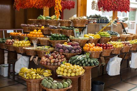 anona: FUNCHAL, MADEIRA, PORTUGAL - SEPTEMBER 12, 2016: Fresh exotic fruits in Mercado Dos Lavradores. Funchal, Madeira, Portugal
