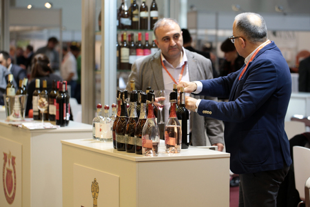 full bodied: CRACOW, POLAND - NOVEMBER 17, 2016:  International Wine Trade Fair ENOEXPO in Cracow .Producers of wine from all around the world meet the importers, distributors and representatives. Cracow. Poland Editorial