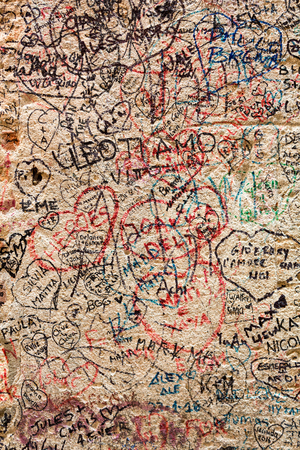 VERONA, ITALY - MAY 1, 2016: Part of the wall covered with love messages in Juliet house, Verona, Italy