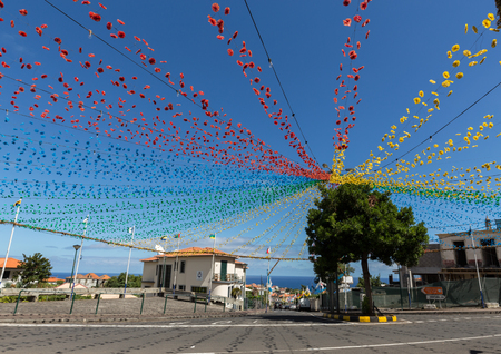 historical events: PONTA DELGADA, PORTUGAL - SEPTEMBER 10, 2016: Garlands, street decorations at  Madeira Wine Festival in Ponta Delgada ,Madeira, Portugal. The Madeira Wine Festival honors the grape harvest with a celebration of traditional local heritage and wine producti