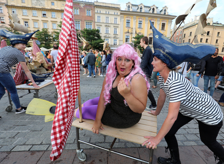 mummery: CRACOW, POLAND - JULY 5, 2017: 30th Street - International Festival of Street Theaters in Cracow, Poland.  An Odyssey Towards New Shores – a street parade