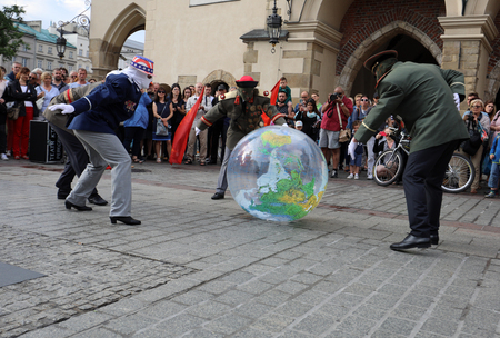 primacy: CRACOW, POLAND - JULY 5, 2017: 30th Street - International Festival of Street Theaters in Cracow, Poland.  An Odyssey Towards New Shores – a street parade