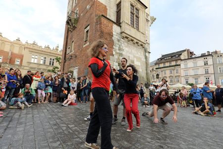 CRACOW, POLAND - JULY 5, 2017: 30th Street - International Festival of Street Theaters in Cracow, Poland.  An Odyssey Towards New Shores – a street parade Banco de Imagens - 81986024