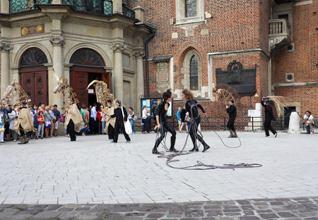 improvisation: CRACOW, POLAND - JULY 5, 2017: 30th Street - International Festival of Street Theaters in Cracow, Poland.  An Odyssey Towards New Shores – a street parade