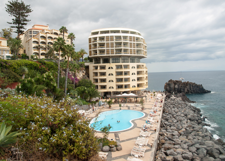 FUNCHAL, PORTUGAL - SEPTEMBER 3, 2016: Swimming pool with tourists at Lido hotels zone in Funchal, Madeira island, Portugal