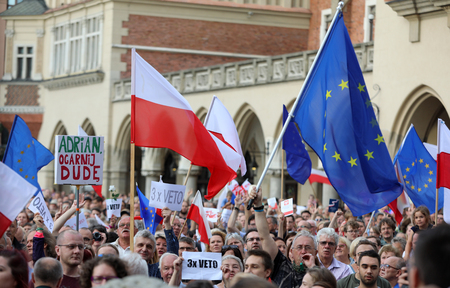 law breaking: CRACOW, POLAND - JULY 23, 2017: Another day in Cracow  thousands of people protest against violation the constitutional law in Poland. Defense of the triad of division of power, free election and independence of the highest court in Poland