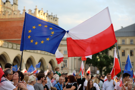 violation: CRACOW, POLAND - JULY 23, 2017: Another day in Cracow  thousands of people protest against violation the constitutional law in Poland. Defense of the triad of division of power, free election and independence of the highest court in Poland