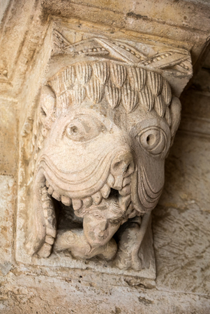 Monster or Tarasque Devouring a Sinner c12th Romanesque Carving in the Cloisters Montmajour Abbey near Arles Provence France
