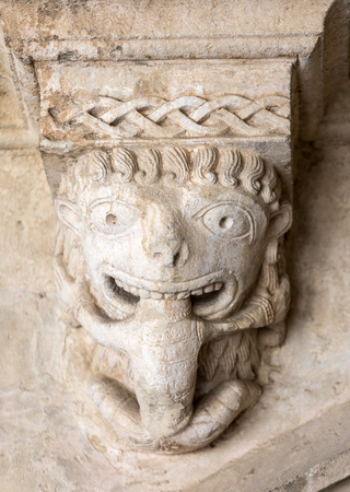 devouring: Monster or Tarasque Devouring a Sinner c12th Romanesque Carving in the Cloisters Montmajour Abbey near Arles Provence France