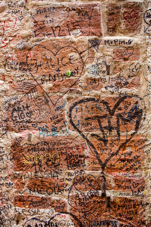 romeo: VERONA, ITALY - MAY 1, 2016: Part of the wall covered with love messages in Juliet house, Verona, Italy
