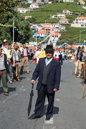 historical events: ESTREITO DE CAMARA DE LOBOS, PORTUGAL - SEPTEMBER 10, 2016: People wearing in traditional costumes at Madeira Wine Festival in Estreito de Camara de Lobos, Madeira, Portugal.