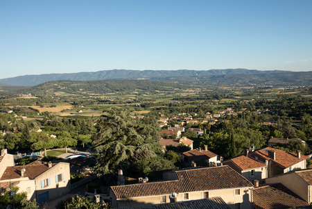 vaucluse: Panoramic view of cultivated fields, vineyards and mountains in Provence, France