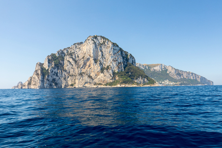 The Island of Capri is a very picturesque, luxuriant and extraordinary location in Italy famous for its high rocks. Banco de Imagens