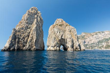 Faraglioni Rocks on Capri Island, Italy. Rocks names left to left: Stella, Mezzo and Scopolo or Fuori