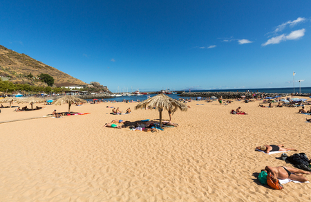 MACHICO, MADEIRA, PORTUGAL - SEPTEMBER 11, 2016: People are resting on a sunny day at the beach in Machico. Madeira Island, Portuga Editorial