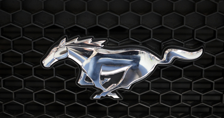 CRACOW, POLAND - MAY 20, 2017: Ford Mustang metallic logo closeup on Ford Mustang  car displayed at  MOTO SHOW in Cracow Poland. Exhibitors present  most interesting aspects of the automotive industry Sajtókép