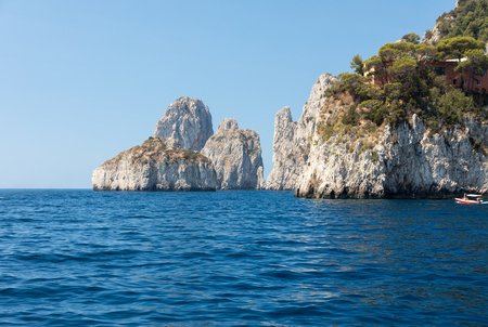 View from the boat on the Faraglioni Rocks on Capri Island, Italy.