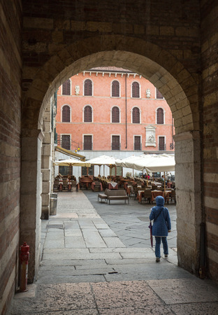 dante alighieri: VERONA, ITALY - MAY 1, 2016: Verona - Piazza dei Signori is the civic and political heart of Verona, Italy