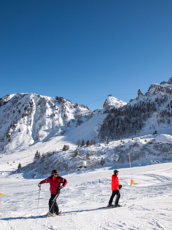 VAL GARDENA, ITALY -  FEBRUARY 07, 2017: Skiing area in the Dolomites Alps. Overlooking the Sella group  in Val Gardena. Italy