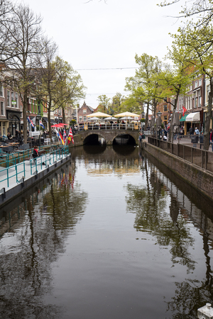 ALKMAAR,  NETHERLANDS - APRIL 21, 2017: Historic 17th century gabled houses at Mient canal, central Alkmaar, Netherlands