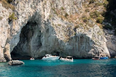 CAPRI, ITALY - JUNE 13, 2017: Boats with tourists near Grotta Bianca and Grotta Meravigliosa, Capri, iATLY