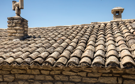 Old fashioned style roof tiles on rural building in Provence France Stock Photo