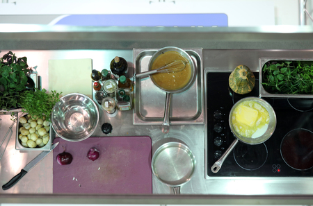Preparing dinner on an induction hob in a home kitchen