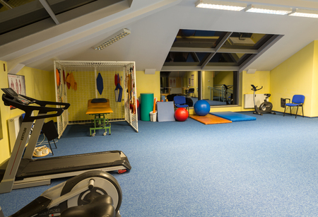 WISLA, POLAND - OCTOBER 23, 2105: Gym and fitness room at the rehabilitation center for the disabled in Wisla, Poland Stock Photo - 91772326