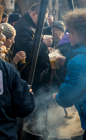 Cracow, Poland - december 17, 2017:   Christmas Eve for poor and homeless on the Main Square in Cracow. Every year the group Kosciuszko prepares the greatest eve in the open air in Poland Editoriali