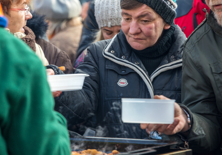 Cracow, Poland - december 17, 2017:   Christmas Eve for poor and homeless on the Main Square in Cracow. Every year the group Kosciuszko prepares the greatest eve in the open air in Poland Editorial