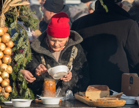 Cracow, Poland - December 17, 2017:   Christmas Eve for poor and homeless on the Main Square in Cracow. Every year the group Kosciuszko prepares the greatest eve in the open air in Cracow. Poland