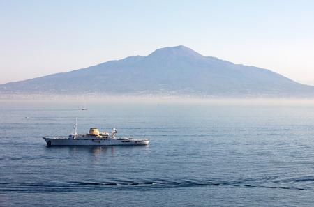 SORRENTO, ITALY - JUNE 13, 2017: Cruise ship in Sorrento gulf with Vesuvio background during a cruise on Capri. Campania, Italy