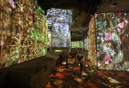 Les Baux, France - June 26, 2017: The Fantastic and Wonderful World of Bosch, Brueghel and Arcimboldo. The show lasts about thirty minutes and contains over 2,000 digital images displayed on an area of 7,000 m2 in the Carrières de Lumières with countless  Editoriali