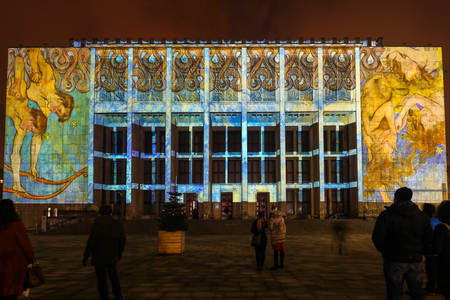 Cracow, Poland - February 3, 2018: Mapping on the facade of the National Museum inspired by the painting of Stanislaw Wyspianski. Krakow, Poland Editorial
